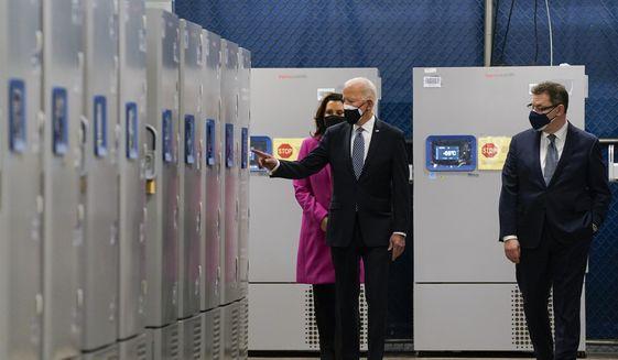 President Joe Biden tours a Pfizer manufacturing site, Friday, Feb. 19, 2021, in Portage, Mich. Michigan Gov. Gretchen Whitmer and Albert Bourla, Pfizer CEO look on. (AP Photo/Evan Vucci) **FILE**