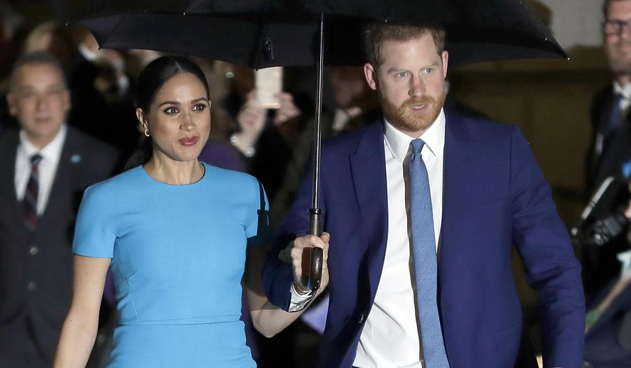 In this March 5, 2020, file photo, Britain's Prince Harry and Meghan, Duchess of Sussex arrive at the annual Endeavour Fund Awards in London.  Harry and Meghan stepped away from full-time royal life in early 2020, and Buckingham Palace on Friday, Feb. 19, 2021, confirmed the couple will not be returning to royal duties, and Harry will give up his honorary military titles. (AP Photo/Kirsty Wigglesworth, File)