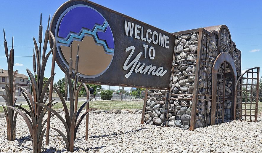 """In this May 23, 2019, photo, is a """"Welcome to Yuma"""" sign in Yuma, Ariz. Overwhelmed border officials have started releasing migrants into Arizona's rural Yuma County as more people arrive amid the coronavirus pandemic with hopes of making their home in America. Yuma Mayor Douglas Nicholls says the U.S. Border Patrol on Monday, Feb. 15, 2021, released a group of 20 people in the neighboring community of San Luis and that several similarly sized groups were let out later in the week. (Randy Hoeft/Yuma Sun via AP) **FILE**"""