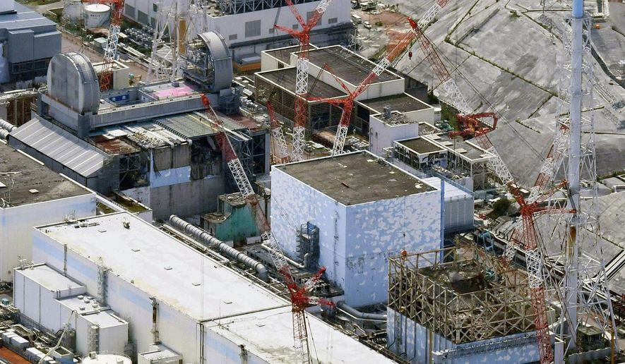 FILE - This Sept. 4, 2017, aerial file photo shows Fukushima Dai-ichi nuclear power plant's reactors, from bottom at right, Unit 1, Unit 2 and Unit 3, in Okuma, Fukushima prefecture, northeastern Japan. The utility operating a wrecked Fukushima nuclear plant said Friday, Feb. 19, 2021, it has detected cooling water levels at two of its three melted reactors have fallen over the past few days apparently due to additional damage done to its reactors from a powerful earthquake that shook the area last weekend.(Daisuke Suzuki/Kyodo News via AP, File)