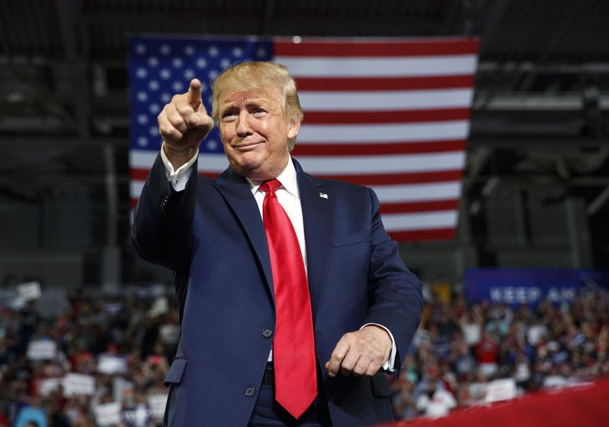 In this Wednesday, July 17, 2019, file photo, President Donald Trump gestures to the crowd as he arrives to speak at a campaign rally at Williams Arena in Greenville, N.C.  (AP Photo/Carolyn Kaster, File)  ** FILE **