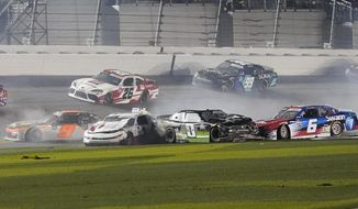 Noah Gragson (9), Michael Annett (1), Jeffrey Earnhardt (0), and Ryan Vargas (6) crash coming out of turn 4 as Brandon Gdovic (26) and Stefan Parsons (99) go high to avoid the wreck during the NASCAR Xfinity Series auto race at Daytona International Speedway, Saturday, Feb. 13, 2021, in Daytona Beach, Fla. (AP Photo/John Raoux)