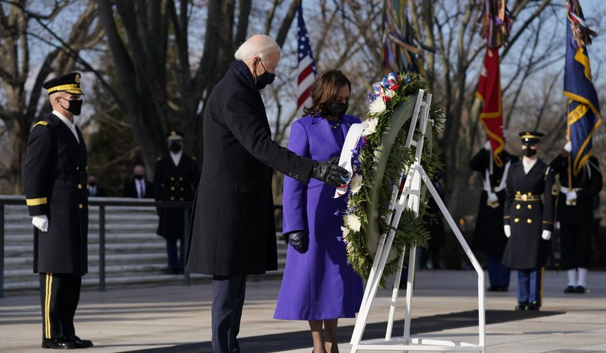 In this Wednesday, Jan. 20, 2021, file photo, President Joe Biden and Vice President Kamala Harris participate in a wreath-laying ceremony at the Tomb of the Unknown Soldier at Arlington National Cemetery in Arlington, Va. (AP Photo/Evan Vucci) ** FILE **