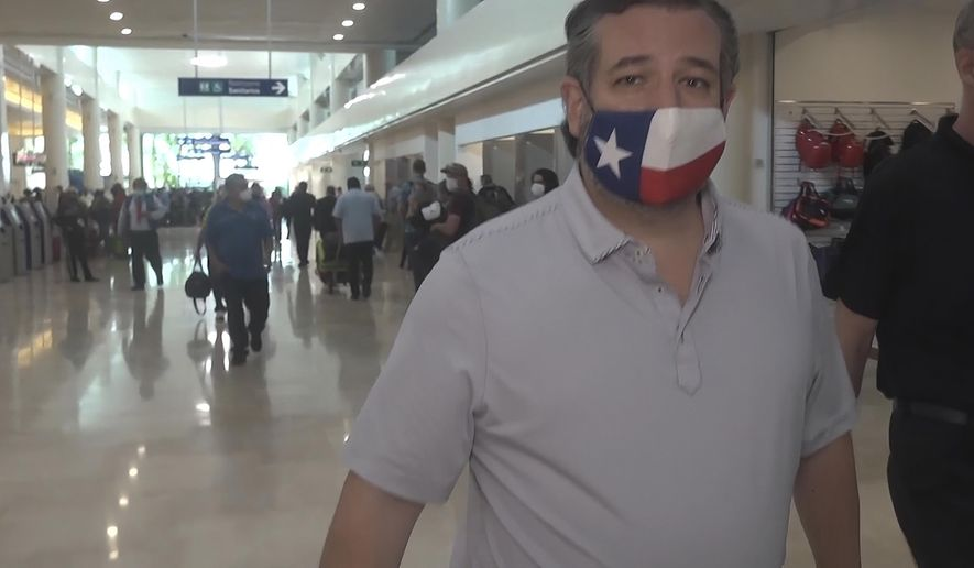 """FILE - In this Thursday, Feb. 18, 2021 image from video, Sen. Ted Cruz, R-Texas, walks to check in for his flight back to the U.S., at Cancun International Airport in Cancun, Mexico. On Friday, Feb. 19, 2021, The Associated Press reported on stories circulating online incorrectly asserting that in 2016, Cruz tweeted, """"I'll believe in climate change when Texas freezes over."""" The tweet is fabricated. It cannot be found on Cruz's verified Twitter account, nor is it on websites that track deleted tweets by public officials. (AP Photo/Dan Christian Rojas)"""