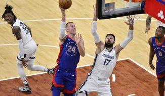 Detroit Pistons center Mason Plumlee (24) shoots against Memphis Grizzlies center Jonas Valanciunas (17) during the second half of an NBA basketball game Friday, Feb. 19, 2021, in Memphis, Tenn. (AP Photo/Brandon Dill)