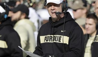 FILE - In this Nov. 24, 2018, file photo, Purdue head coach Jeff Brohm looks on during the second half of an NCAA college football game against Indiana in Bloomington, Ind. Brohm did not like how his defense performed last season so he shook it up. He fired defensive coordinator Bob Diaco after one season, hired three new assistants and got more involved in the defensive meetings. Now it is time to find out how much has changed. (AP Photo/Darron Cummings, File)