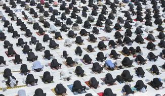 File - In this Friday, Sept. 11, 2020 file photo, Shiites attend a prayer or the first time in months since the restrictions were imposed to prevent the spread of the coronavirus at a mosque in Kufa, Iraq. (AP Photo/Anmar Khalil, File)