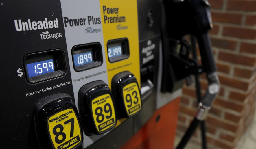 Prices are seen on a gas pump, Tuesday, March 31, 2020, in Brandon, Miss. Earlier in the week, U.S. gasoline prices had dropped to their lowest levels in four years, and they are almost sure to go lower as oil prices plunge. (AP Photo/Julio Cortez)