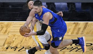 Orlando Magic center Nikola Vucevic, right, is fouled by Golden State Warriors guard Stephen Curry (30) during the second half of an NBA basketball game, Friday, Feb. 19, 2021, in Orlando, Fla. (AP Photo/Phelan M. Ebenhack)