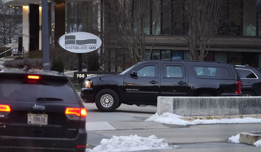 President Biden's motorcade departs the Watergate complex after Biden made a stop to visit with former Sen. Bob Dole, Saturday, Feb. 20, 2021, in Washington. (AP Photo/Patrick Semansky)  **FILE**
