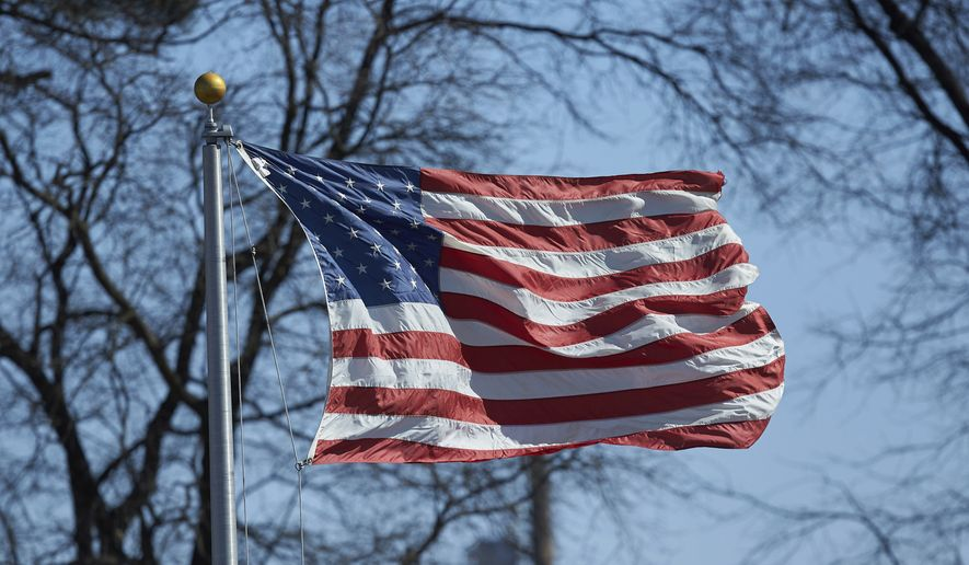 The American flag blows in the breeze. (AP Photo/Brian Westerholt) ** FILE **