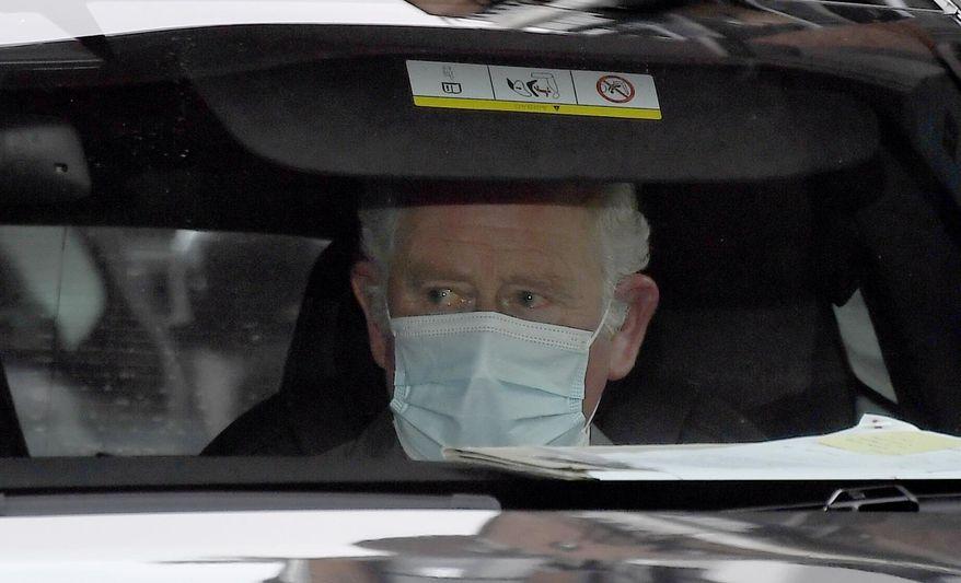 Britain's Prince Charles leaves the King Edward VII's hospital by car in London, Saturday Feb.20, 2021, following a visit to see his father Prince Philip. Buckingham Palace said the husband of Queen Elizabeth II, 99-year-old Prince Philip was admitted to the private King Edward VII Hospital on Tuesday evening after feeling unwell.(AP Photo/Alberto Pezzali)