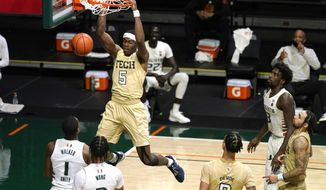 Georgia Tech forward Moses Wright (5) dunks during the first half of an NCAA college basketball game against Miami, Saturday, Feb. 20, 2021, in Coral Gables, Fla. (AP Photo/Lynne Sladky)