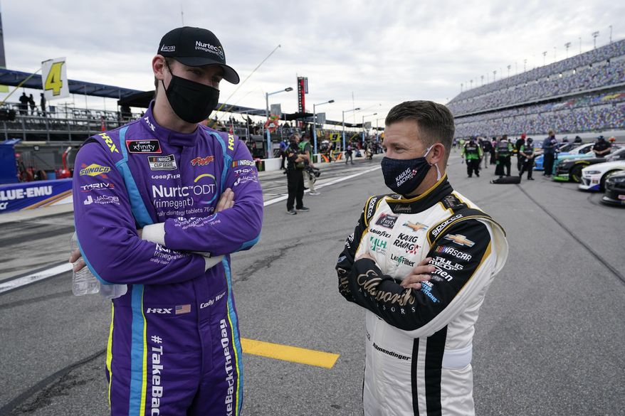 Cody Ware, left, and A J Allmendinger talk on pit road before the NASCAR Xfinity Series auto race at Daytona International Speedway, Saturday, Feb. 13, 2021, in Daytona Beach, Fla. (AP Photo/John Raoux)