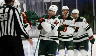 Kevin Fiala (22) celebrates his goal with teammates on the bench during the second period of an NHL hockey game against Anaheim Ducks Saturday, Feb. 20, 2021, in Anaheim, Calif. (AP Photo/Ringo H.W. Chiu)