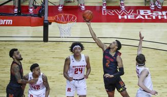 Maryland guard Aaron Wiggins (2) shoots and scores as Rutgers guard Ron Harper Jr. (24) watches during the first half of an NCAA college basketball game in Piscataway, N.J., Sunday, Feb. 21, 2021. (Andrew Mills/NJ Advance Media via AP)