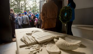 A wreath is laid and the tomb is a place to celebrate on George Washington's birthday. (The Washington Times)