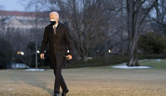 President Joe Biden walks on the South Lawn of the White House after stepping off Marine One, Friday, Feb. 19, 2021, in Washington. Biden is returning to Washington after visiting Pfizer's COVID-19 vaccine manufacturing site near Kalamazoo, Mich. (AP Photo/Patrick Semansky)