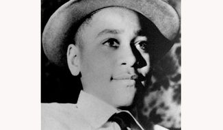FILE - This undated photo shows Emmett Louis Till, a 14-year-old black Chicago boy, who was kidnapped, tortured and murdered in 1955 after he allegedly whistled at a white woman in Mississippi. A Republican and a Democratic senator say Congress should give the nation's highest civilian honor posthumously to Emmett Till and his mother, Mamie Till-Mobley. GOP Sen. Richard Burr, R-N.C., and Sen. Cory Booker, D-N.J., say the Congressional Gold Medal is long overdue for the Till family.  (AP Photo, File)