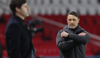 Monaco's head coach Niko Kovac is seen after his player Guillermo Maripan scores against PSG as PSG's head coach Mauricio Pochettino looks during the French League One soccer match between Paris Saint Germain and Monaco, at the Parc des Princes stadium, in Paris, France, Sunday, Feb. 21, 2021. (AP Photo/Francois Mori)