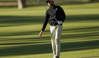 Sam Burns reacts after hitting his second shot on the 18th hole as third round play continues during the Genesis Invitational golf tournament at Riviera Country Club, Sunday, Feb. 21, 2021, in the Pacific Palisades area of Los Angeles. (AP Photo/Ryan Kang)