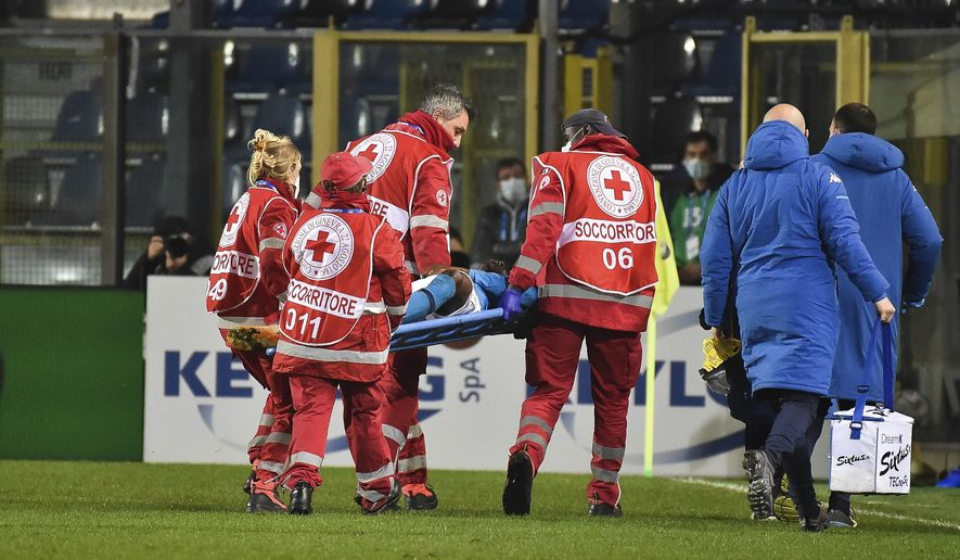 Napoli's Victor Osimhen is carried away on a stretcher during a Serie A soccer match between Atalanta and Napoli, in Bergamo's Atleti Azzurri d'Italia stadium, Italy, Sunday, Feb. 21, 2021. (Gianluca Checchi/LaPresse via AP)