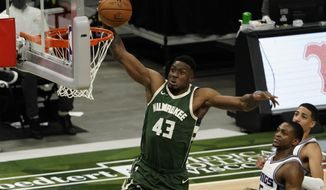 Milwaukee Bucks' Thanasis Antetokounmpo dunks during the second half of an NBA basketball game against the Sacramento Kings Sunday, Feb. 21, 2021, in Milwaukee. (AP Photo/Morry Gash)