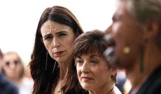 New Zealand's Prime Minister Jacinda Ardern, left, attends the 10th anniversary memorial service of the 2011 Christchurch earthquake in Christchurch, New Zealand, Monday, Feb. 22, 2021. Monday marked a decade since the quake struck, killing 185 people. (George Heard/NZ Herald via AP)