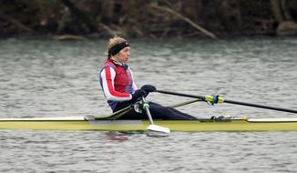 Rower Gevvie Stone trains at Lady Bird Lake ahead of the upcoming U.S. Olympic rowing trials, Friday, Feb. 12, 2021, in Austin, Texas. Stone is getting closer to a hopeful return to the Olympics and eventually the medical career she has put on hold for nearly three years. The silver medalist at the 2016 Rio de Janeiro Olympics came out of retirement and postponed her medical career as an emergency physician for one last chance at a gold medal.  (AP Photo/Eric Gay) **FILE**