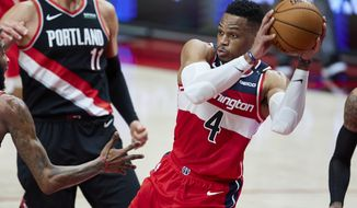 Washington Wizards guard Russell Westbrook looks to pass the ball during the first half of the team's NBA basketball game against the Portland Trail Blazers in Portland, Ore., Saturday, Feb. 20, 2021. (AP Photo/Craig Mitchelldyer)