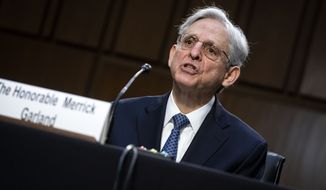 Judge Merrick Garland, nominee to be Attorney General, testifies at his confirmation hearing before the Senate Judiciary Committee, Monday, Feb. 22, 2021 on Capitol Hill in Washington.  (Al Drago/Pool via AP)