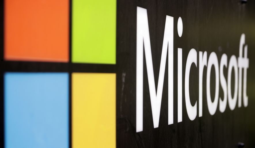 In this Wednesday, Feb. 3, 2021 file photo, the Microsoft company logo is displayed at their offices in Sydney. (AP Photo/Rick Rycroft, File)