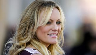 "In this Oct. 11, 2018, photo, adult film actress Stormy Daniels attends the opening of the adult entertainment fair ""Venus"" in Berlin. (AP Photo/Markus Schreiber) **FILE**"
