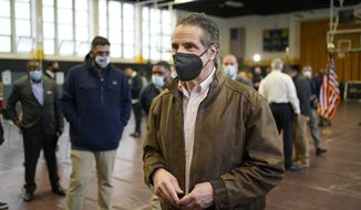 New York Gov. Andrew Cuomo walks through a COVID-19 vaccination site after speaking in the Brooklyn borough of New York, Monday, Feb. 22, 2021. (AP Photo/Seth Wenig, Pool)