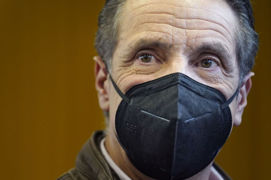 New York Gov. Andrew Cuomo walks through a COVID-19 vaccination site after speaking in the Brooklyn borough of New York, Monday, Feb. 22, 2021. (AP Photo/Seth Wenig, Pool) ** FILE **