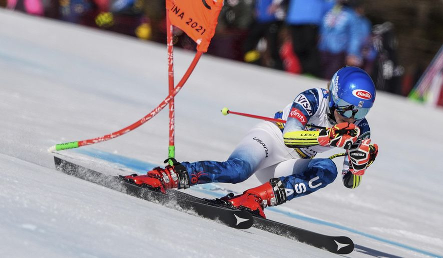 United States' Mikaela Shiffrin speeds down the course during a women's giant slalom, at the alpine ski World Championships, in Cortina d'Ampezzo, Italy, Thursday, Feb. 18, 2021. (AP Photo/Giovanni Auletta) **FILE**