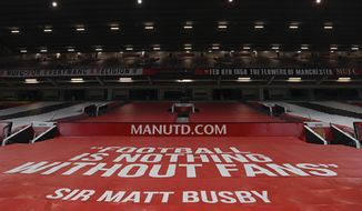 A general view of empty stands at the Old Trafford stadium before the English Premier League soccer match between Manchester United and Southampton, in Manchester, England, Tuesday, Feb. 2, 2021. (Laurence Griffiths/Pool via AP)