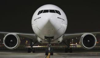 CORRECTS DATE TO EARLY SUNDAY FEB. 21, 2021 - An Emirates Airlines Boing 777 arrives from Brussels to deliver Pfizer-BioNTech COVID-19 coronavirus vaccines shipment at Dubai International Airport in Dubai, United Arab Emirates, early Sunday, Feb. 21, 2021. As the coronavirus pandemic continues to clobber the aviation industry, Emirates Airlines, the Middle East's biggest airline is seeking to play a vital role in the global vaccine delivery effort. (AP Photo/Kamran Jebreili)