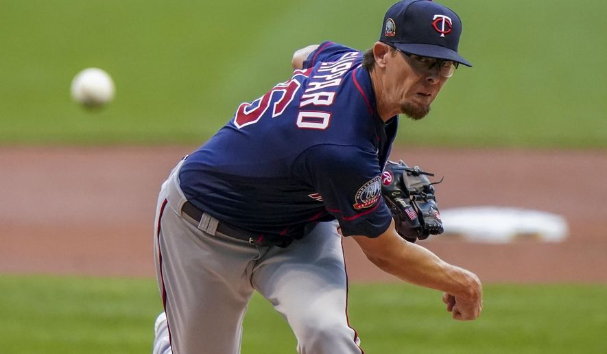 FILE - In this Aug. 11, 2020, file photo, Minnesota Twins' Tyler Clippard throws during the first inning of a baseball game against the Milwaukee Brewers in Milwaukee. The Arizona Diamondbacks have agreed to a $2.25 million, one-year contract with Clippard, a person with knowledge of the negotiations told The Associated Press. The agreement was reached on Monday, Feb. 22, 2021, and confirmed to the AP on condition of anonymity because the deal is pending a physical. (AP Photo/Morry Gash, File)