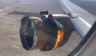 """In this image taken from video, the engine of United Airlines Flight 328 is on fire after after experiencing """"a right-engine failure"""" shortly after takeoff from Denver International Airport, Saturday, Feb. 20, 2021, in Denver, Colo. The Boeing 777 landed safely and none of the passengers or crew onboard were hurt. (Chad Schnell via AP)"""