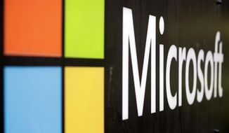 In this Wednesday, Feb. 3, 2021, file photo, the Microsoft company logo is displayed at their offices in Sydney. (AP Photo/Rick Rycroft, File)  ** FILE **