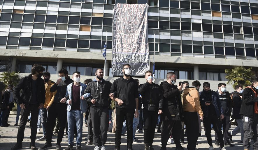 Protesters chant slogans at the University of Thessaloniki in northern Greece, on Monday, Feb. 22, 2021. Police clashed with protesters and detained more than 30 people in Greece's second-largest city Monday during a demonstration against a new campus security law. (AP Photo/Giannis Papanikos)