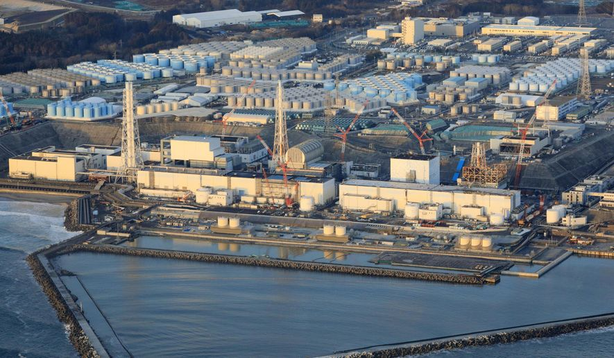 This aerial photo shows the Fukushima Dai-ichi nuclear power plant operated by Tokyo Electric Power Company (TEPCO) in Okuma town, Fukushima prefecture, northeastern Japan, on Feb. 14, 2021, a day after a strong earthquake. TEPCO says both of two seismometers at Unit 3, one of three melted reactors, had been out of order since last week and were not able to collect data when the powerful earthquake struck the area on Feb. 13, calling into question if the company's risk management has improved since the disaster. (Hironori Asakawa/Kyodo News via AP)