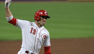 """FILE - Cincinnati Reds' Joey Votto reacts as he runs the bases after hitting a solo home run in the third inning during a baseball game against the Pittsburgh Pirates in Cincinnati, in this Monday, Sept. 14, 2020, file photo. Votto is determined to be a power-hitter again. """"I want to get back to being dangerous,"""" the 37-year-old first baseman said from Cincinnati Reds spring training complex in Goodyear, Arizona.(AP Photo/Aaron Doster, File)"""