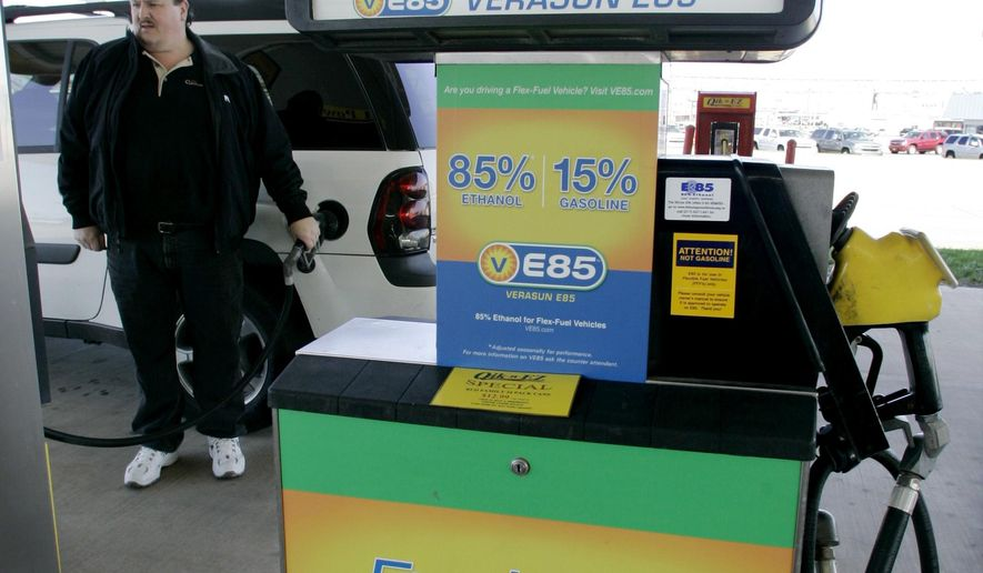 FILE - This April 4, 2007 file photo, shows a gas pump in that delivers Ethanol fuel. The federal government announced Monday, Feb. 22, 2021, that it will support the ethanol industry in a lawsuit over biofuel waivers granted to oil refineries under President Donald Trump's administration. The Environmental Protection Agency said it is reversing course and will support a January 2020 decision by the Denver-based 10th U.S. Circuit Court of Appeals in a lawsuit filed by the Renewable Fuels Association and farm groups. (AP Photo/M. Spencer Green File)