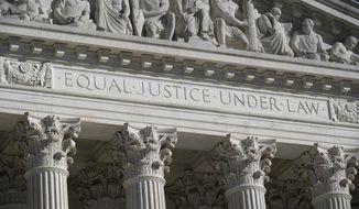This Nov. 4, 2020, file photo shows the Supreme Court in Washington. (AP Photo/J. Scott Applewhite)