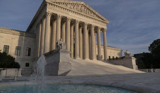 In this Nov. 5, 2020, file photo, the Supreme Court is seen in Washington. (AP Photo/J. Scott Applewhite) ** FILE **