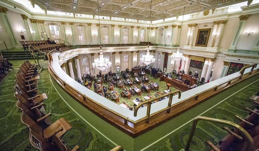 FILE - In this Aug. 31, 2020, file photo, is the Assembly gallery overlooking a legislative session in Sacramento, Calif. California lawmakers on Monday, Feb. 22, 2021, approved a COVID stimulus package that includes $600 in cash for 5.7 million people. (AP Photo/Hector Amezcua, File)