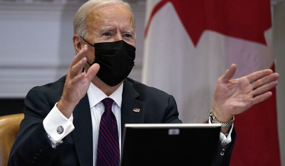 President Joe Biden holds a virtual bilateral meeting with Canadian Prime Minister Justin Trudeau, in the Roosevelt Room of the White House, Tuesday, Feb. 23, 2021, in Washington. (AP Photo/Evan Vucci)