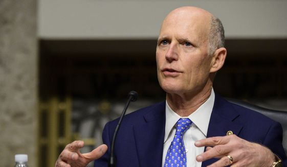 In this file photo, Sen. Rick Scott, R-Fla., speaks during a Senate Homeland Security and Governmental Affairs & Senate Rules and Administration joint hearing on Capitol Hill, Washington, Tuesday, Feb. 23, 2021, to examine the January 6th attack on the Capitol. (Erin Scott/The New York Times via AP, Pool)  **FILE**